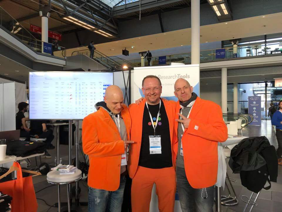 Christoph C. Cemper has more than one orange jacket